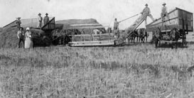 historic photo of farmers and equipment at harvest