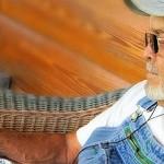 farmer using his iPad and listening through headphones